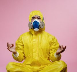 Person In Yellow Protective Suit Doing A Yoga Pose 3951367