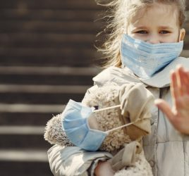 Serious Girl In Protective Mask Holding Plush Toy In Mask 4000605