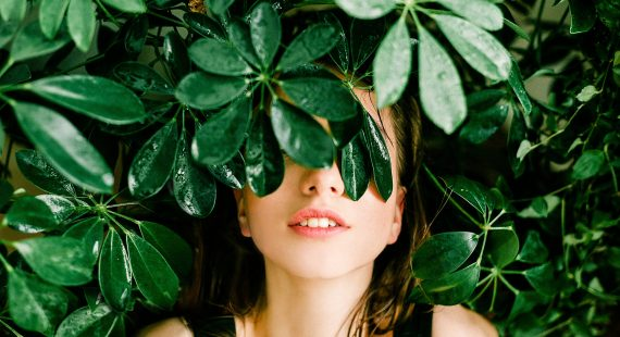 Woman In Black Top Beside Green Leafed Plant 1078058