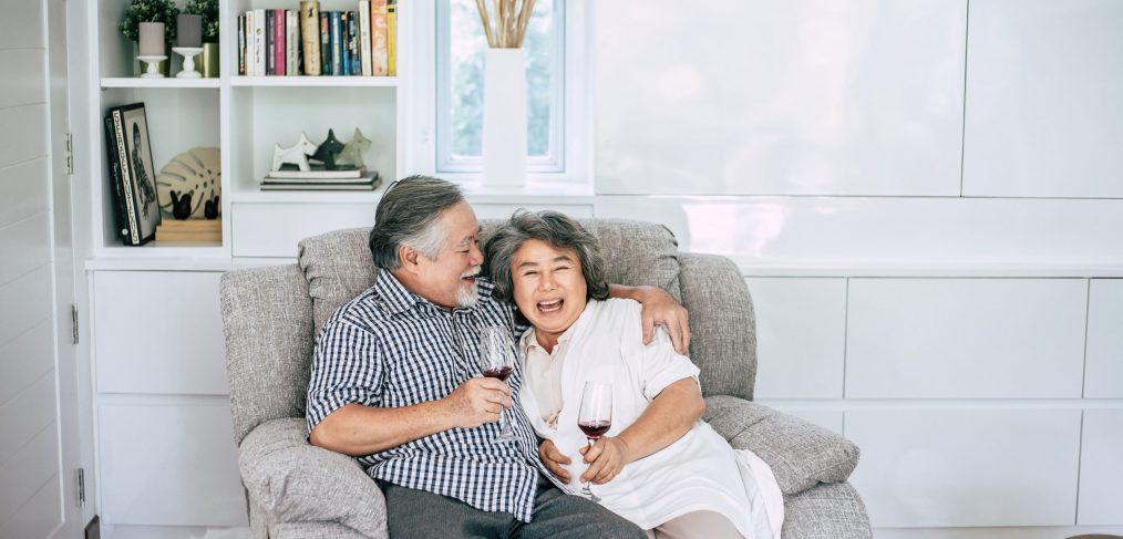 happy elderly woman and her husband drinking wine and happiness